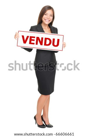 French real estate agent holding french sold sign - agent immobilier avec pancarte vendu.
