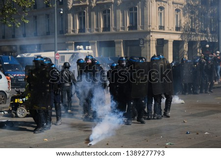 French riot police clash with French yellow vests protesters during a demonstration called by the Yellow vest movement against the policy of Emmanuel Macron  in Paris, France on Apr. 20, 2019  #1389277793