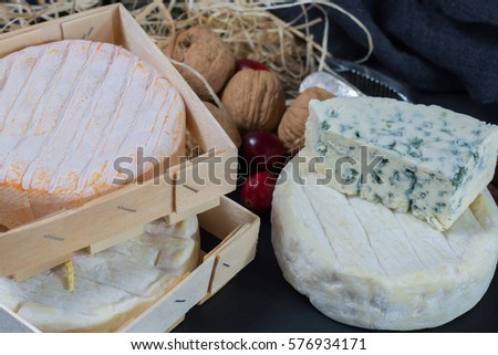French soft cheeses on black stone platter #576934171