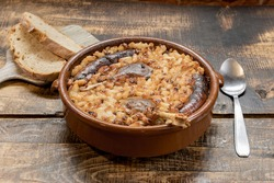 French specialty: cassoulet, a meal with white beans, duck leg, sausage and bacon.