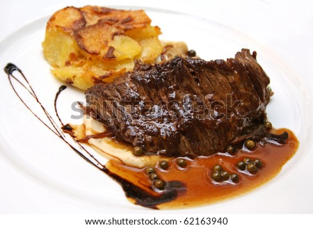 French steak with mashed potatoes and pepper