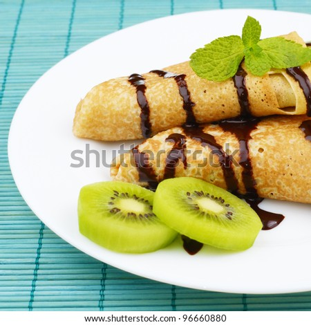 French style kiwi crepes with chocolate syrup