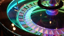 French style roulette table for money playing in Las Vegas, USA. Spinning wheel with black and red sectors for risk game of chance. Hazard amusement with random algorithm, gambling and betting symbol.