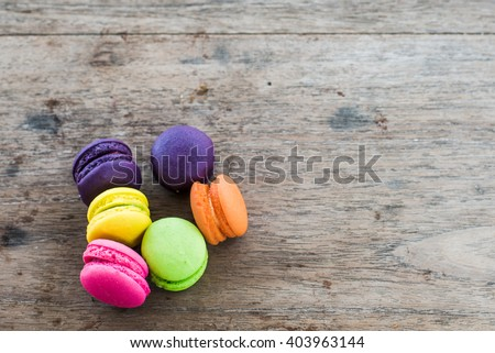 french sweet delicacy, colourful macaroons variety with wood Background - Shutterstock ID 403963144