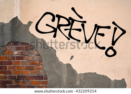 French text Greve (strike) - Handwritten graffiti sprayed on the wall, anarchist aesthetics. Appeal to fight for good conditions for employees at work. Uprising against exploitation
