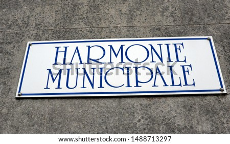 French text: Harmonie municipale. English translation: Municipal Harmony (municipal school of music and fanfare). Panel on a wall.