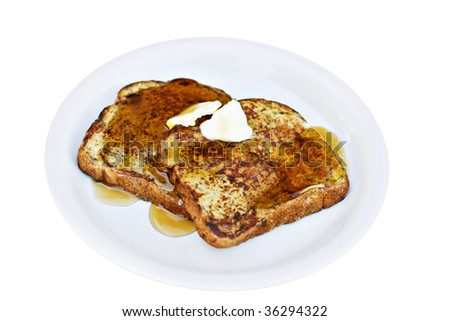 French toast made from raisin bread with syrup and butter. Shallow DOF. Clipping path included.