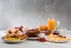 french toast, scrambled egg, omelette, peanut butter and jelly sandwich, fruit juice, compellent breakfast, morning , daylight, stone background, copy space