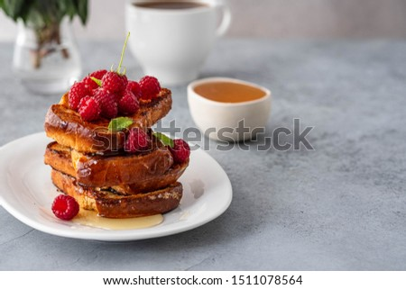 French toasts, French toasts made of sliced brioche with fresh raspberries, honey and mint. Delicious breakfast or dessert #1511078564