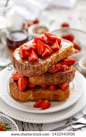 French toasts, French toasts made of sliced brioche with fresh strawberries and honey.  Delicious breakfast or dessert #1432943900