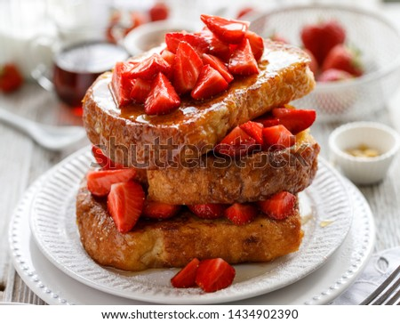 French toasts, French toasts made of sliced brioche with fresh strawberries and honey.  Delicious breakfast or dessert #1434902390