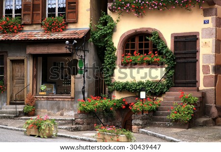 French traditional house with half-timbered wall. La route du vin, route of vines, Dambach village in Alsace - France.