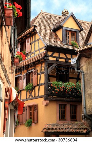 French traditional house with half-timbered wall. La route du vin , route of vines, village in Alsace - France. Dambach la ville.