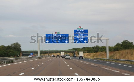 french traffic signal to go to Paris on the motorway in France #1357440866