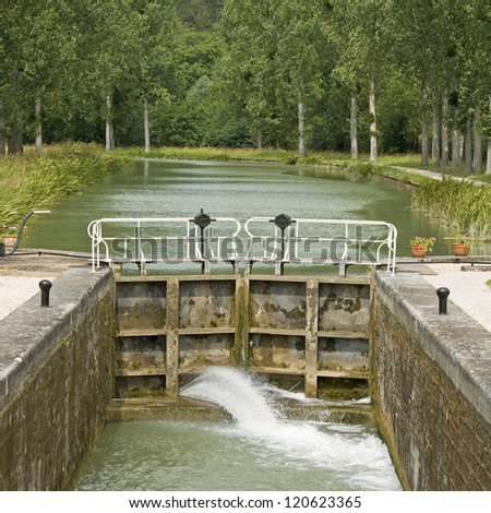 French waterway, lock gate Canal Bourgogne. France.