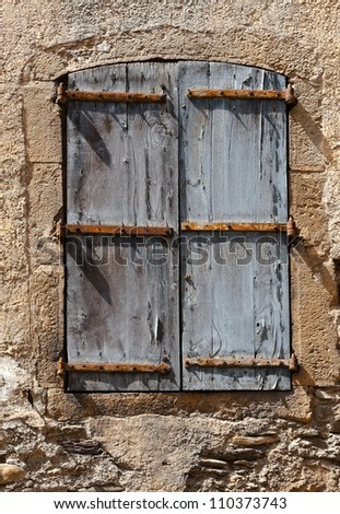 French Window with Closed Wooden Shutter
