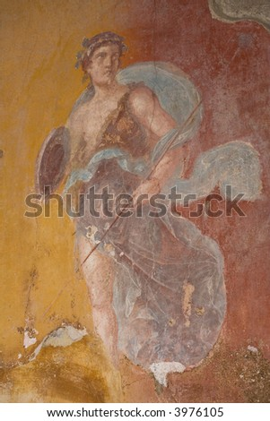 Fresco from Pompeii, Italy. The mural depicts a young man (maybe a god)