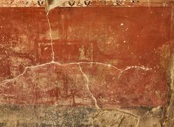 Fresco in a wall of t Fullonica Di Stephanus in Via della Abbondanza at Ruins of Pompeii. The city was an ancient Roman city destroyed by the volcano Vesuvius. Pompei, Campania, Italy.