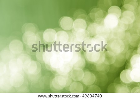 Fresh abstract background, green magic lights, bokeh.