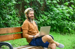 Fresh air. Mobile internet. You can work anywhere. Agile business. Bearded guy sit on bench in park nature background. Work and relax. Online shopping. Working online. Hipster inspired work in park.