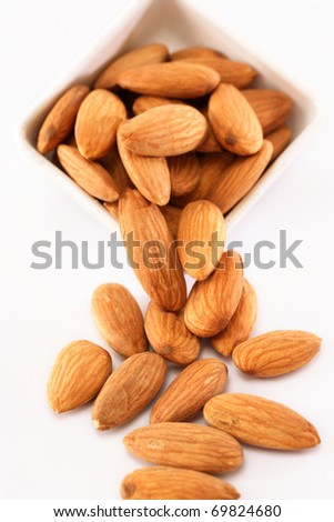 Fresh almonds on white
