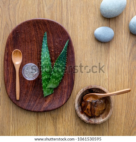 fresh aloe vera gel in wooden cup hand-made extracted from leaves from the plant, natural ingredient for organic moisturizing bodycare and aromatherapy #1061530595