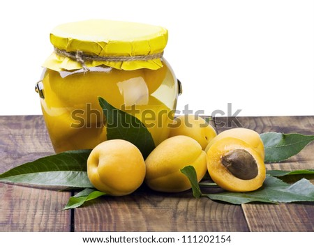 fresh and canned apricot isolated on white background