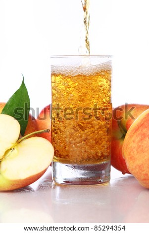 Fresh and cold apple juice against white background