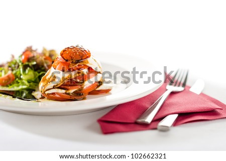 Fresh and delicious Caprese salad with tomatoes isolated on white