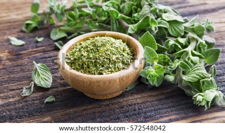 Shutterstock Fresh and dried oregano herb on wooden background