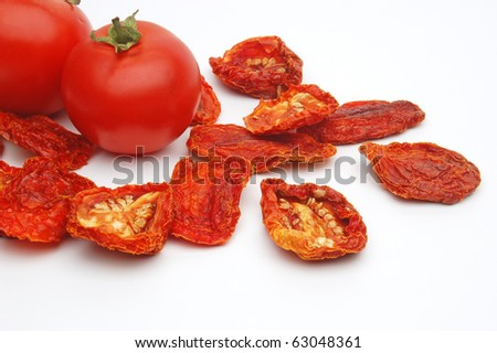Fresh and dried tomatoes on white background