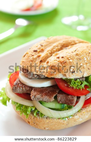 Fresh and healthy sandwich with vegetables and beef sliced