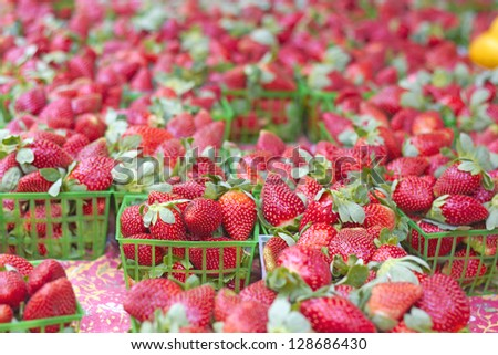 Fresh and juicy strawberries for sale at the market. Horizontal Shot.