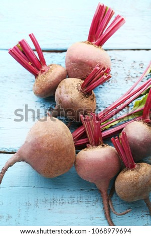 Fresh and ripe beets on blue wooden table