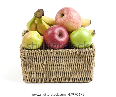 Fresh and ripe fruits in a grass crate isolated on white background
