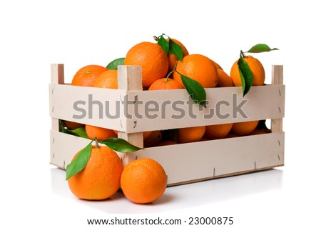Fresh and ripe orange fruits with leaves in a wooden crate isolated on white background - stock photo