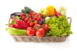 Fresh and ripe vegetables arranged in a basket isolated on white. Healthy vegan food.