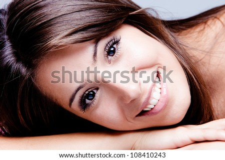 fresh and smiling young woman portrait studio shot