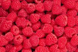 Fresh and sweet raspberries background