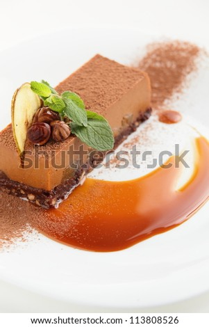 fresh and tasty cake on white dish and white background