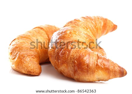Fresh and tasty croissant over white background