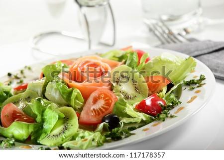 fresh and tasty european salad on white dish - stock photo