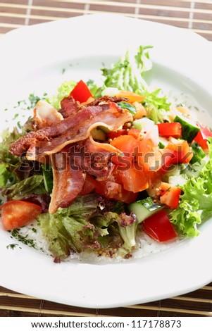 fresh and tasty european salad on white dish