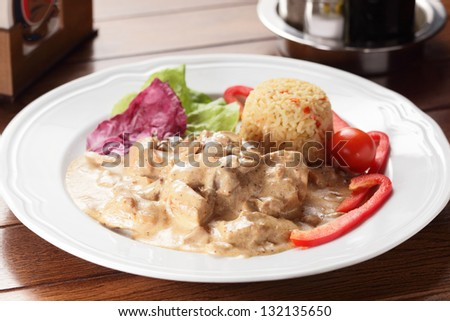 fresh and tasty peaces of meat with garnish - stock photo