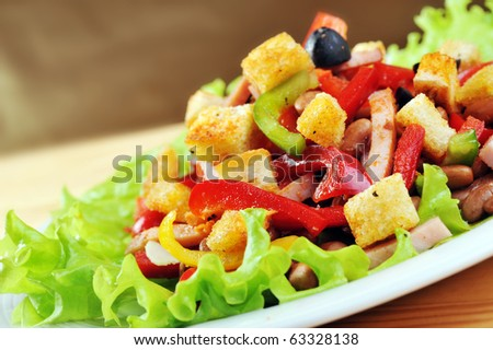 Fresh and tasty salad  on plate, wooden table