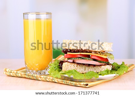 Fresh and tasty sandwich on plate on table on light background Foto d'archivio ©