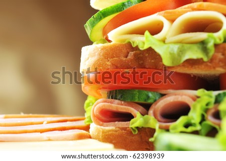 Fresh and tasty sandwich on wooden  table