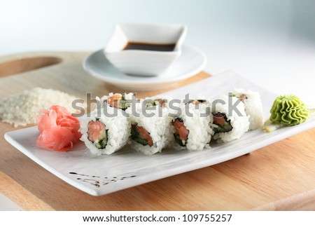 fresh and tasty sushi on bright background