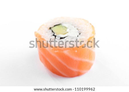 fresh and tasty sushi on bright background