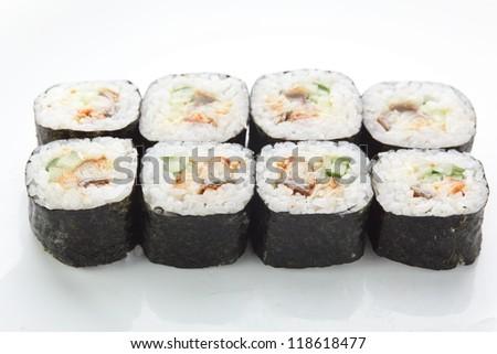 fresh and tasty sushi on white reflective background